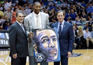 Tracy McGrady honored during halftime of the Magic-Pelicans game on November 1, 2013. (Photo Credit: John Raoux/Ap Photos)